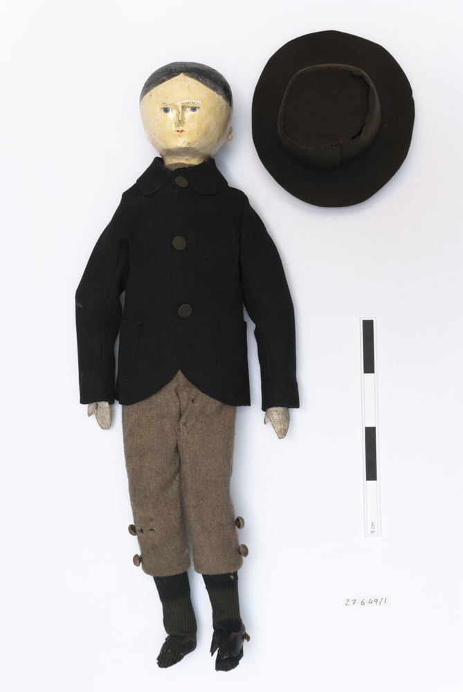 doll (pastimes: toys); hats (clothing: headwear)