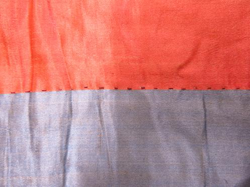 Detail view of hand stitching on outside of Horniman Museum object no 27.4.61/94