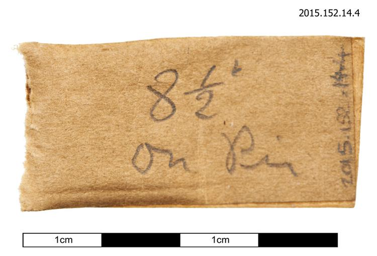 General view of spare string instruction for tuning pin winding of Horniman Museum object no 2015.152.14.4