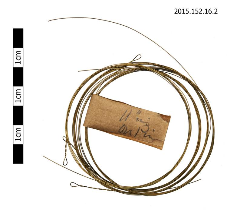 General view of spare string with instruction for tuning pin winding of Horniman Museum object no 2015.152.16.2