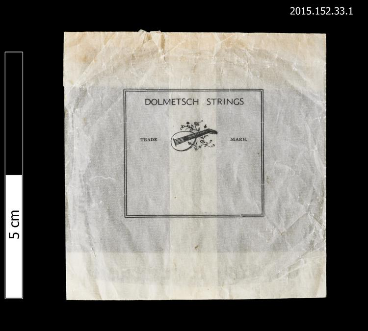 General view of envelope for spare string with Dolmetsch logo of Horniman Museum object no 2015.152.33.1