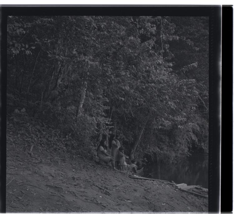 Black and white medium format negative of trees and people