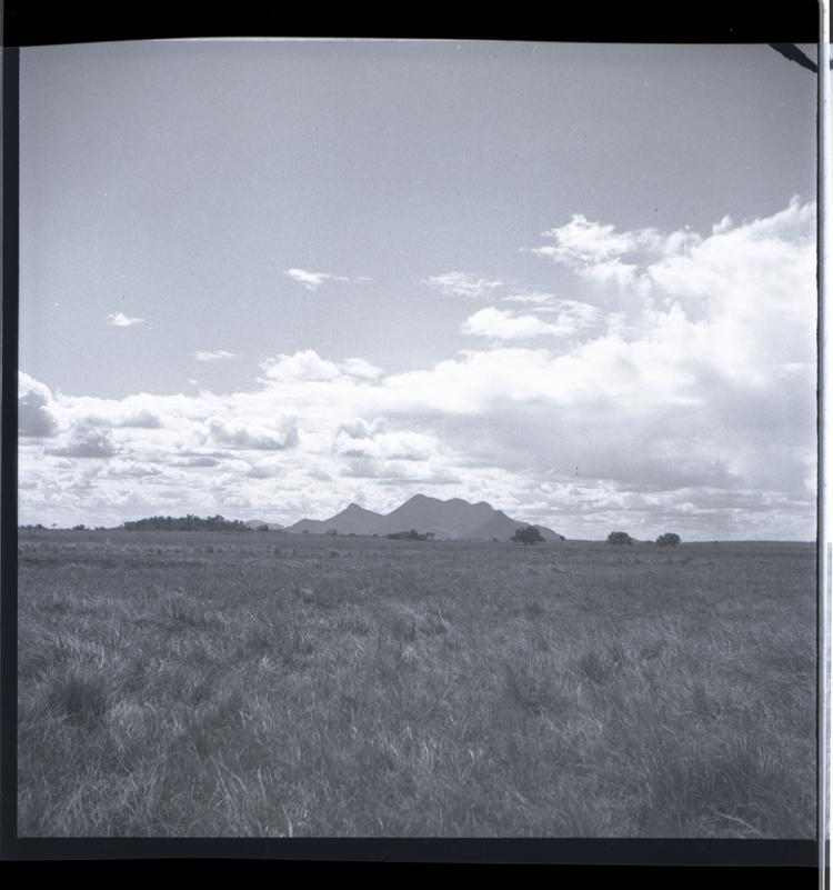 Black and white medium format negative of mountains in distance