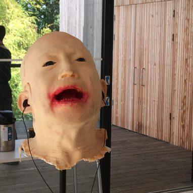 Open mouthed mask of head on a pole