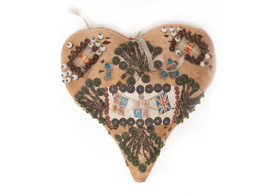 Heart charm with buttons and beads.