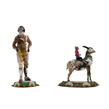 three figures - a man, a small man riding a goat and a kangaroo - all figures are made up of lots of other animals