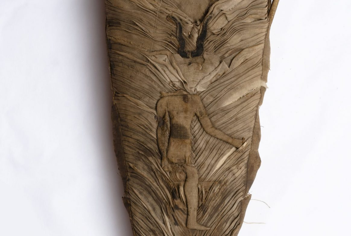 Mummy with decoration of person with horns on head