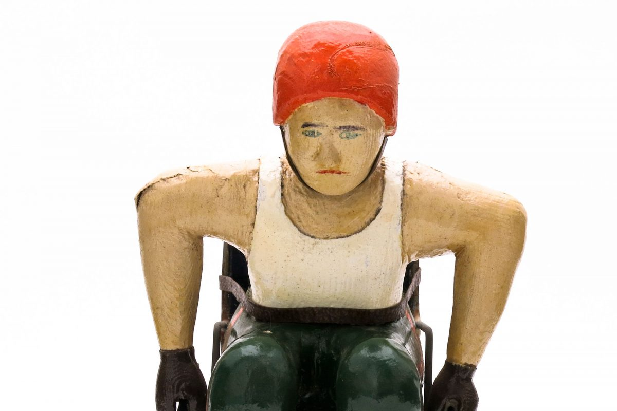 Carved wooden wheelchair figure