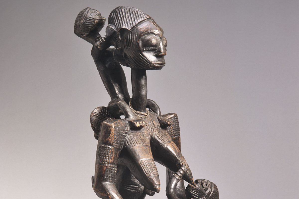 Seated wooden female with children
