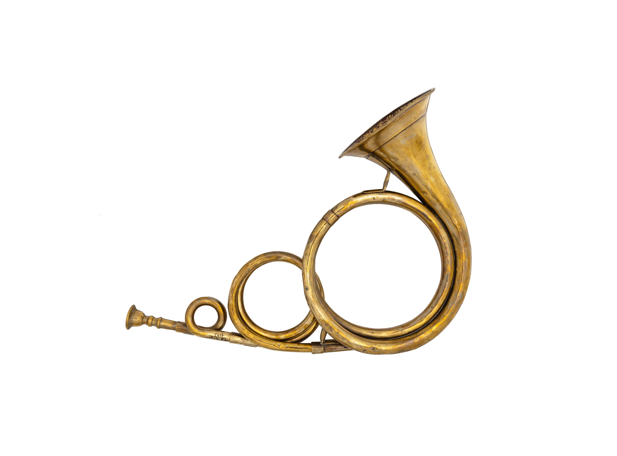 A golden metal horn with three loops getting bigger as the move away from the mouthpiece until it reaches the wider horn, where the sound comes out.