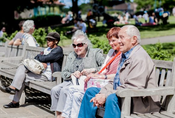 Older people enjoying the Gardens, sat on a bench