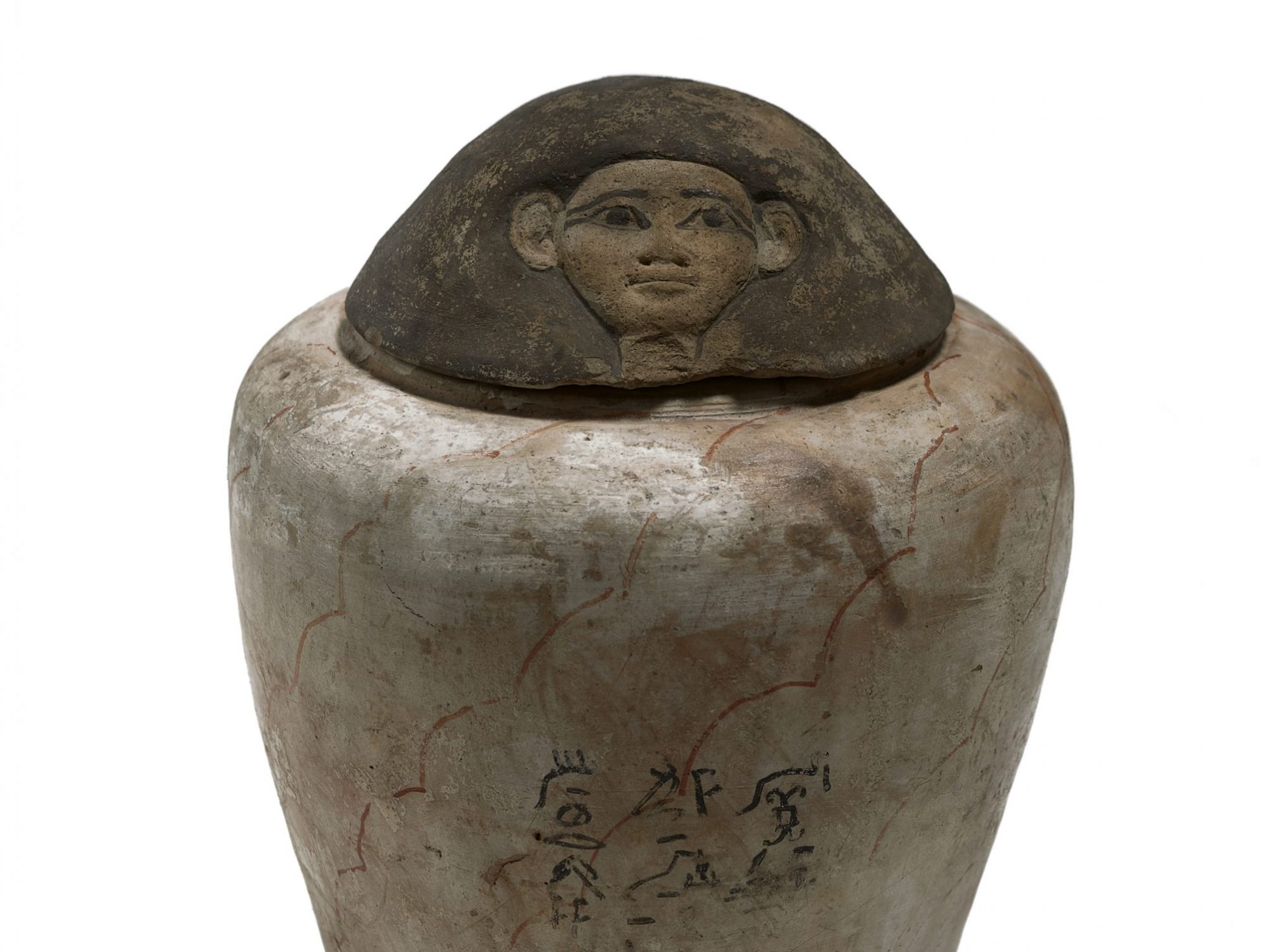 Brown jar with shape of head on top