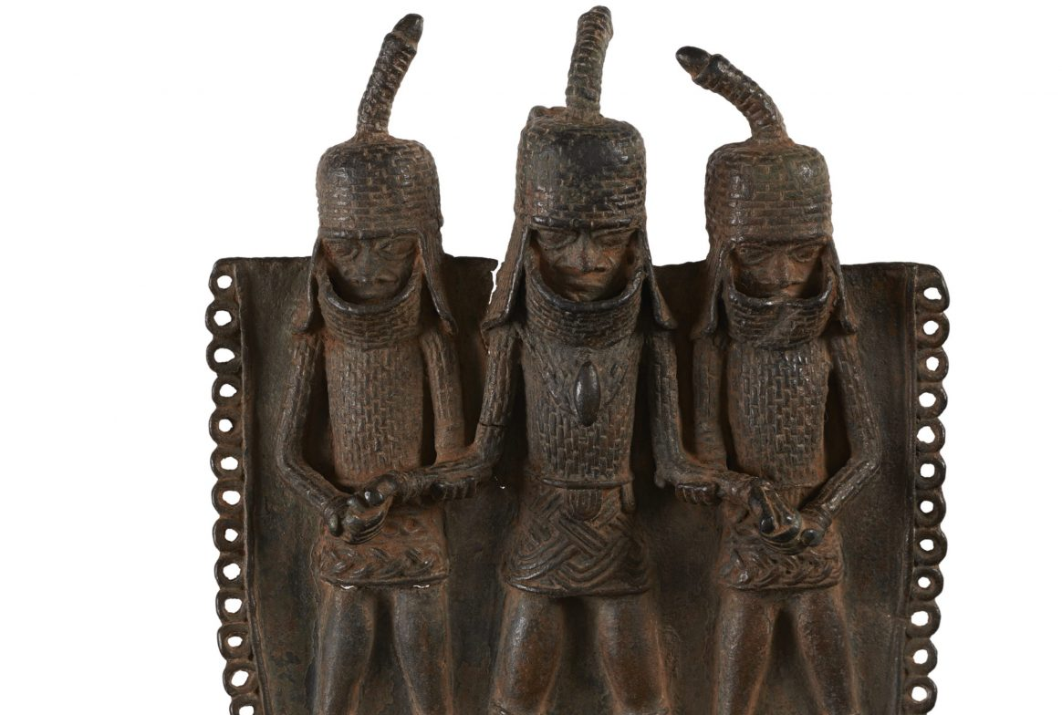 neck ornament with three people as decoration