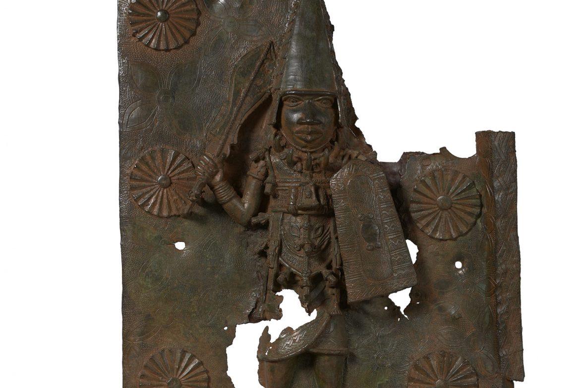 Partial bronze plaque of man