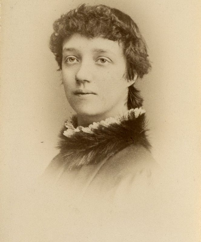 A sepia portrait of a woman's head