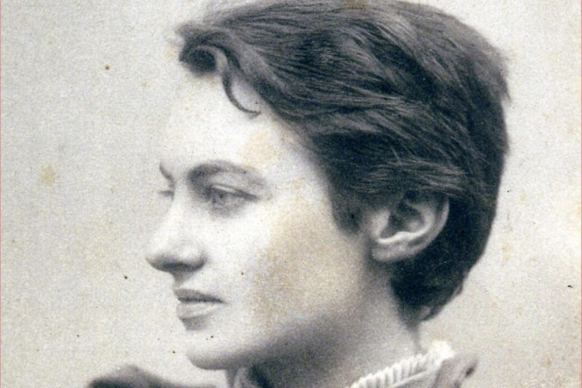 A black and white photo of a woman looking to the left of the camera