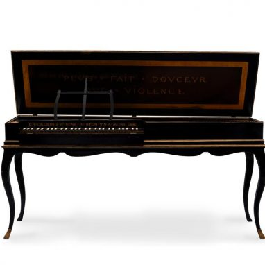 dark wood clavichord on a stand