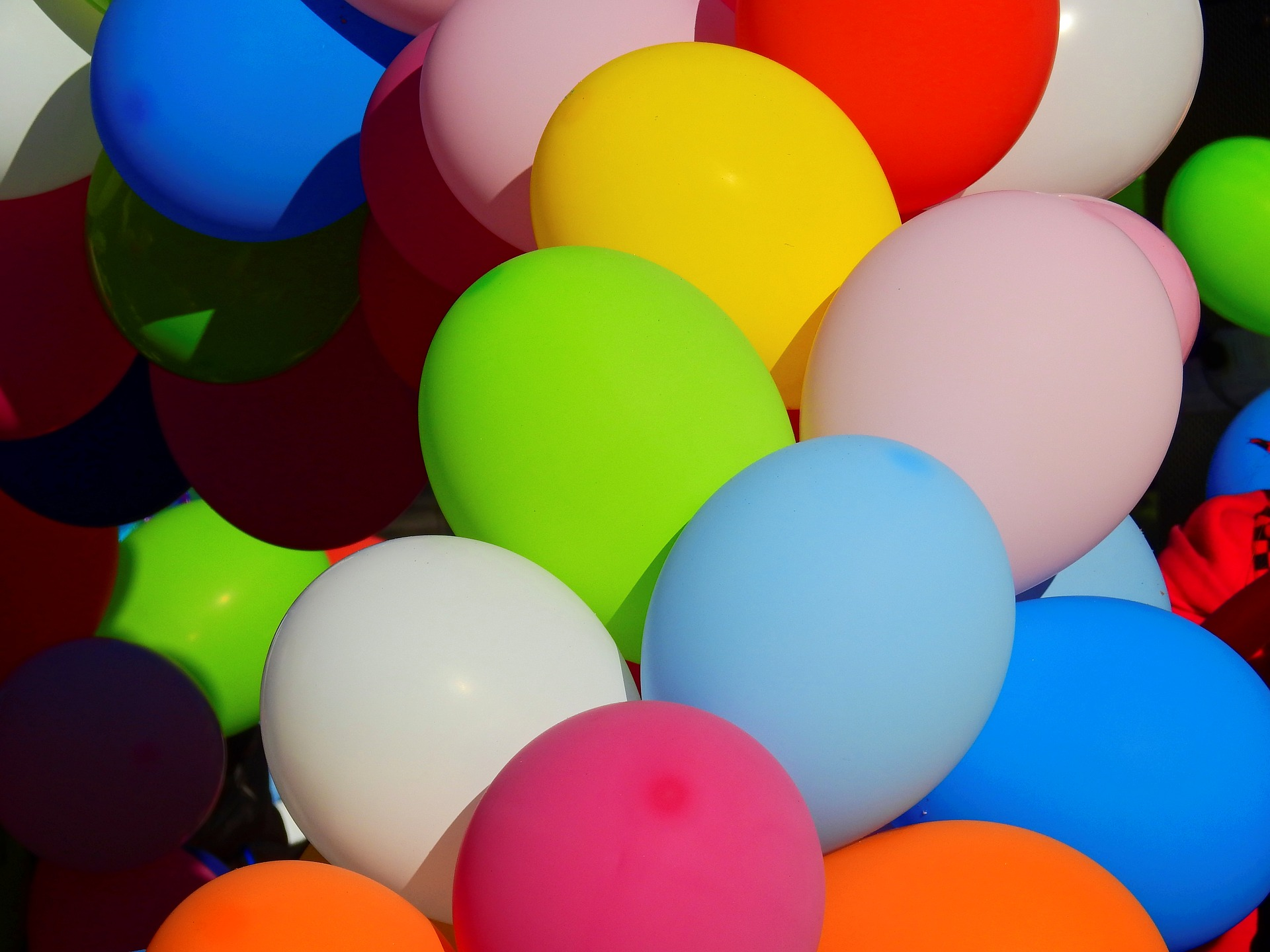A big bunch of balloons of many colours