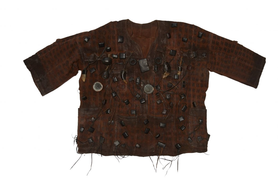 Dark brown tunic with screws and bolts sewn on top.
