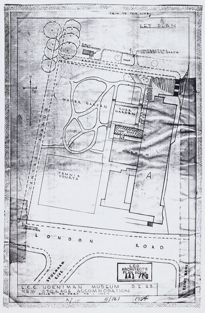 A photocopy of a paper showing plans of an outside space with green areas marked and a water garden, next to a building that is the Horniman Museum
