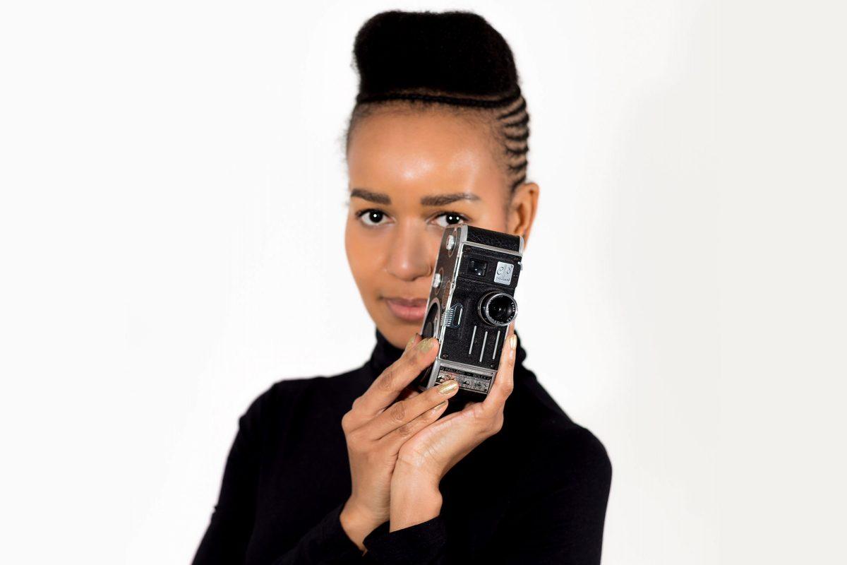 Sherry Davis posing with a camera