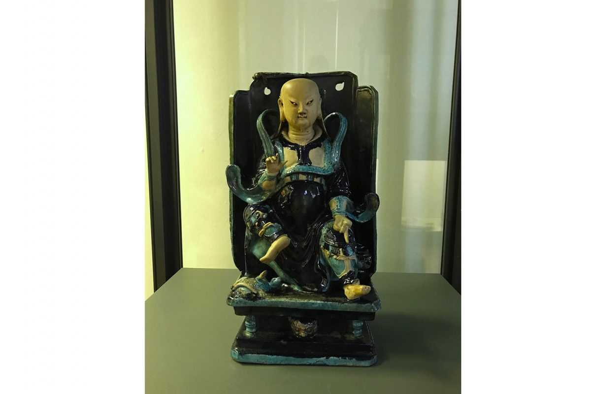 Figure of man sitting in chair