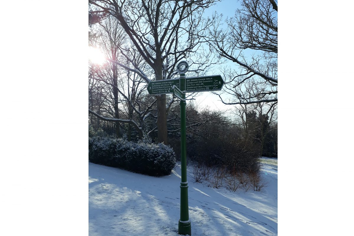 Sign post in Gardens on snowy day