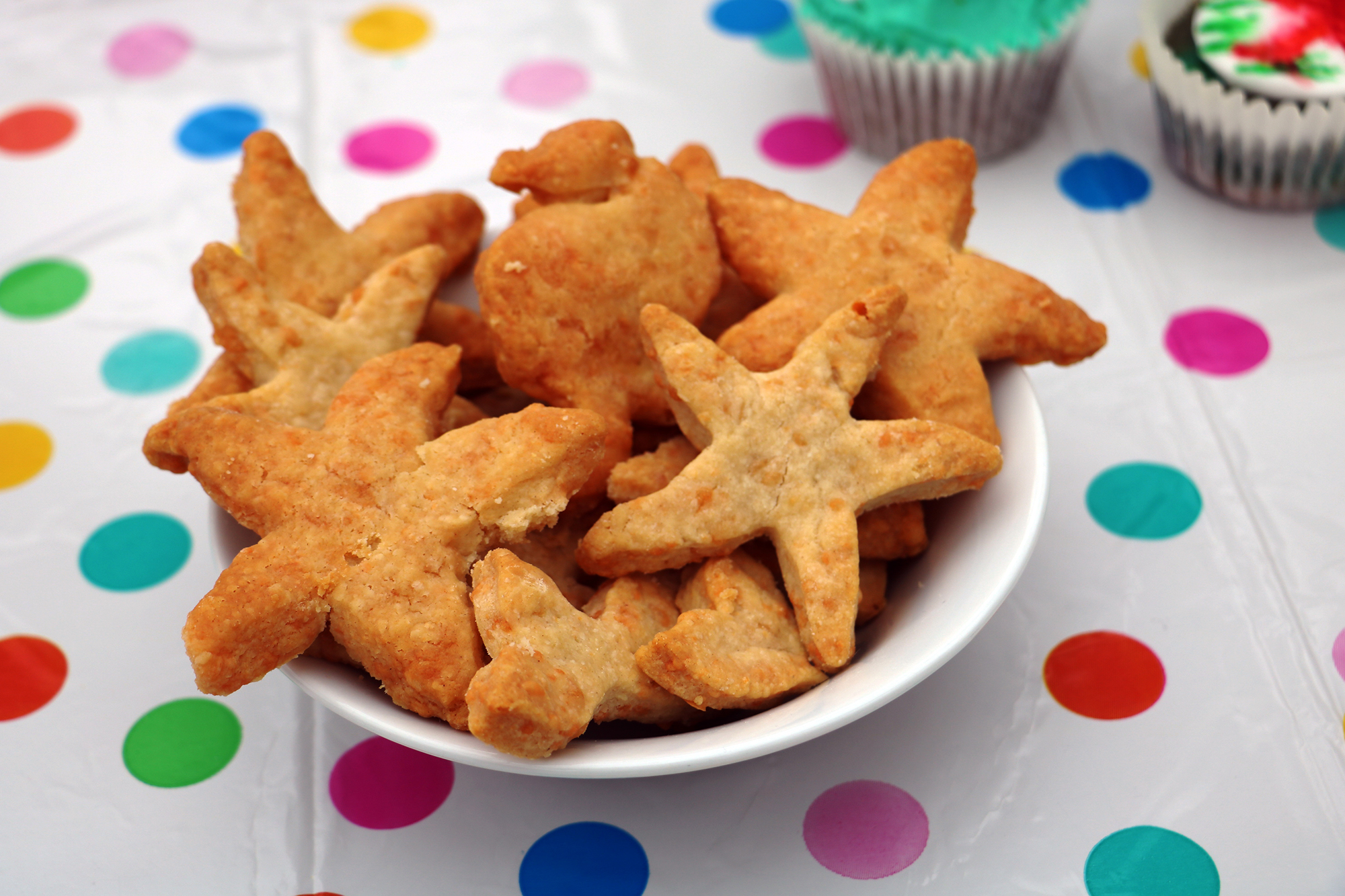 starfish shaped biscuits in a white bowl on table.