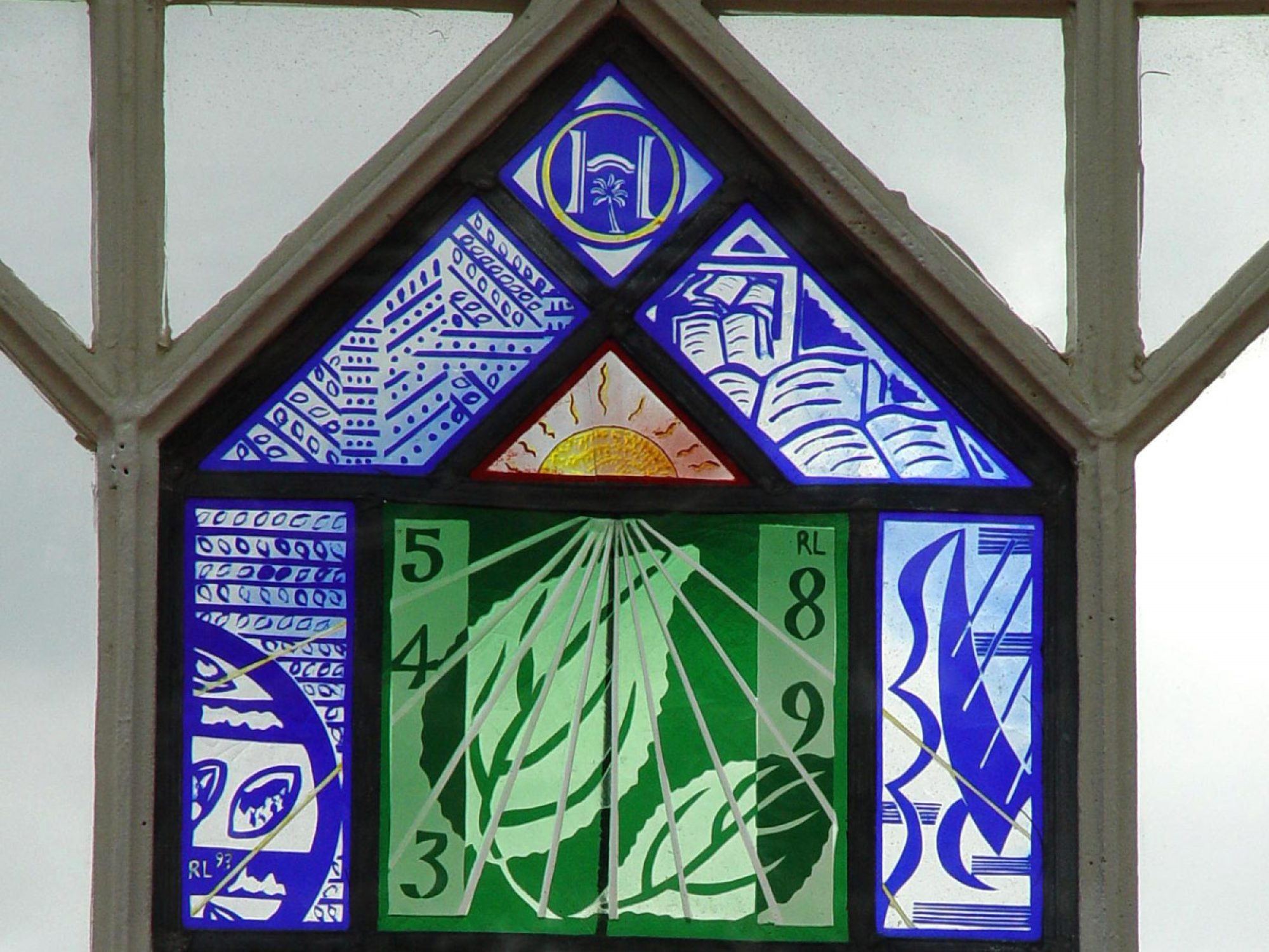 A stained glass panel, which is also a sundial