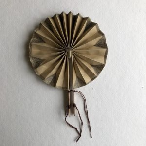 Circular fan with holding sticks.