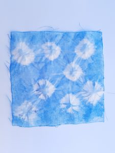Square fabric died blue with white pattern
