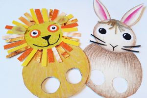 Two flat finger puppets - a lion and a rabbit