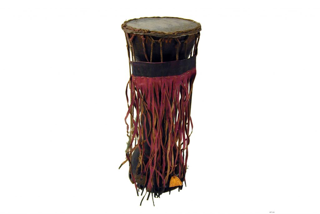 Long cylinder drum with red strings wrapped around the center.