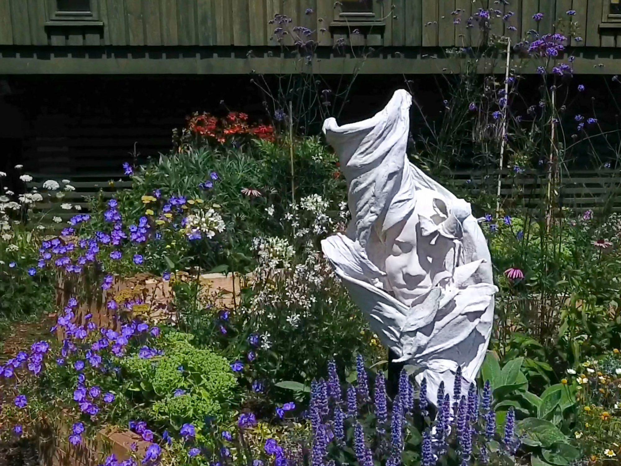 A sculpture of a girl in the Horniman Bee Garden