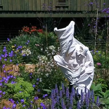A sculpture of a girl in the Horniman Bee Garden