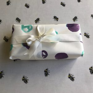 Present wrapped with spotted paper and white ribbon