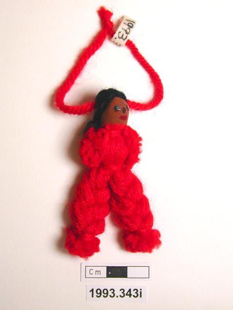 Red woollen doll shaped like male.
