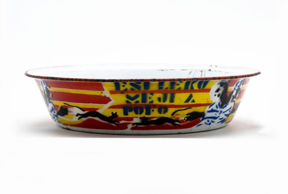 yellow and red striped bowl on a white background