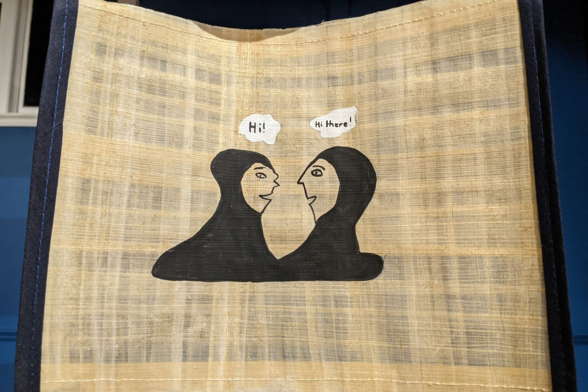 Picture of two women in headscarfs saying hi