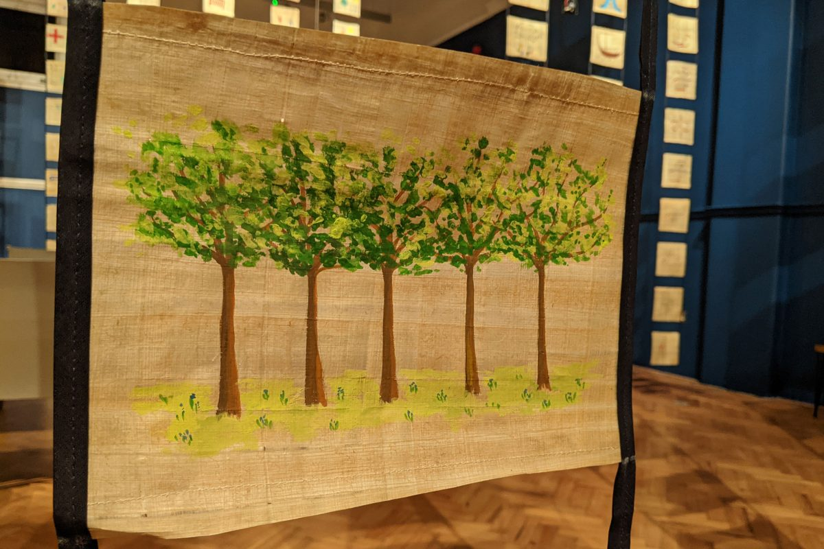 A drawing of trees on a scroll
