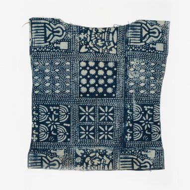 Square sample of blue fabric with various patterns in squares.