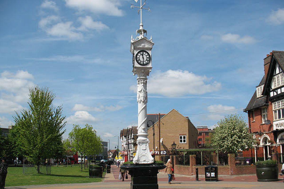 A white metal clock tower