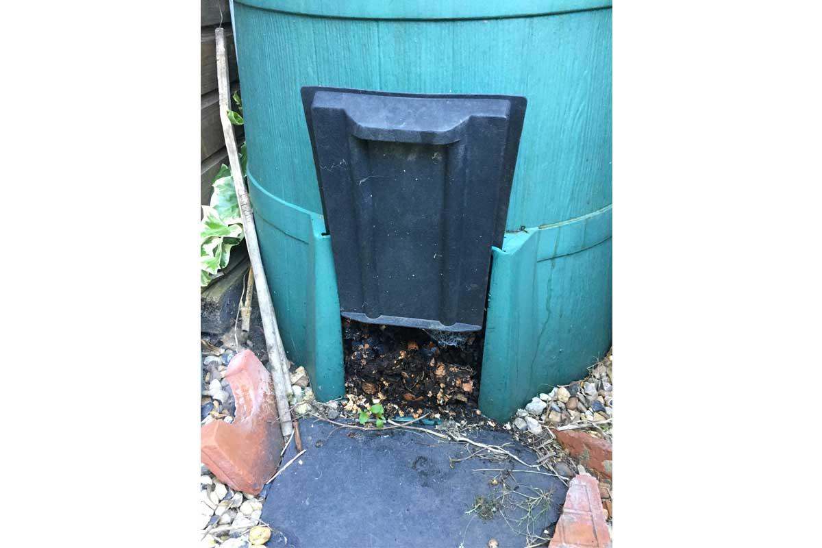 Door at the bottom of a compost bin